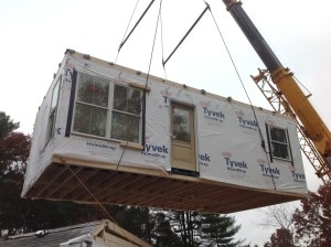 The crane hoists the modular unit and places on the foundation.